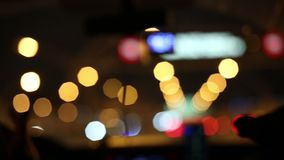 Defocused lights of city street abstract . car lights 50 mm lens blur background. Moving bokeh circles of night traffic. stock video footage