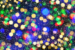 Defocused lights with snowfall effect. winter night. abstract ba Royalty Free Stock Photo