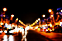 Defocused lights of the street. Elysian Fields, Paris, Arc de Triomphe in the background Stock Photography