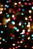 Defocused ljus bokeh för julgran Arkivfoto