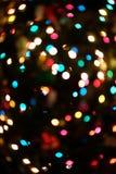 Defocused ljusbokeh för julgran Fotografering för Bildbyråer