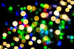 Defocused ljusjulgarneringar Semestrar bakgrund fotografering för bildbyråer