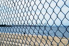 Defocused logistics and security concept of narrow depth of field on gate on port stock photos