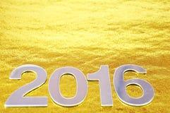 Defocused lub 2016 liczb nad złotym tłem Zdjęcie Royalty Free