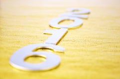 Defocused lub 2016 liczb nad złotym tłem Zdjęcia Stock