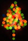 Defocused mehrfarbiges Weihnachtsbaumschattenbild Stockfoto