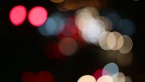 Defocused night traffic lights in big City. Abstract. Defocused night traffic lights in big City stock video