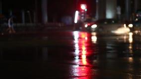 Defocused night traffic lights on a Rainy Day in Samutprakarn,Thailand. With Rain Reflection stock footage