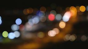 Defocused nocy światła ruchu od samochodów tło abstrakcyjna plama zbiory wideo