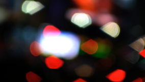 Defocused NYC Times Square Lights. Camera defocused (optical, not done in post) shot of people and cars going by on busy New York City street facing towards stock footage