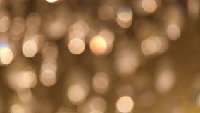 Defocused particles moving sparkles. Abstract blur with blinking bokeh bright party lights. Merry Christmas. 4k stock footage