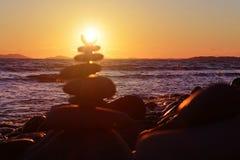 Defocused pebble pyramid and transparent sea background. Orange royalty free stock images