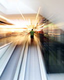 Defocused people. Blurred unrecognizable people in motion in a shopping mall Royalty Free Stock Images