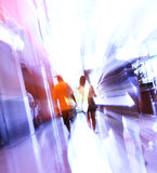Defocused people. Blurred unrecognizable people in motion in a shopping mall Royalty Free Stock Photo
