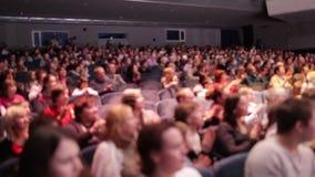 Defocused people applaud after the premiere. stock footage