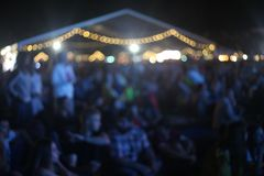 Defocused people at open air music festival stock photography