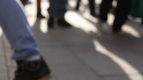 Defocused people walking on the street. Defocused silhouettes of people walking on the streetn stock footage