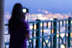 Defocused photographer taking photos Royalty Free Stock Images