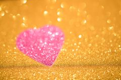 Silver glitter heart on gold background stock images