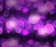 Defocused purple light dots against background Stock Image