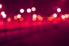 Defocused röda, purpurfärgade vita ljus Arkivbilder