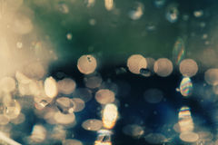 Defocused raindrops on a glass wallpaper Stock Photography