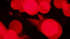Defocused red lights with bokeh, motion background Royalty Free Stock Photography