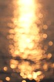 Defocused Reflections. Defocused sun reflections on a turquoise sea surface Stock Photo