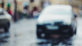 Defocused road with cars. Defocused road with traffic after rain. Cars moving on stock video footage