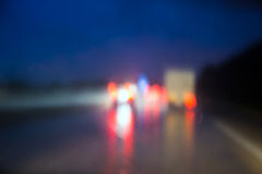 Defocused road lights. Blurred traffic at night road as seen through windscreen Stock Photography