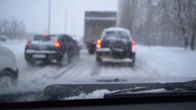 Defocused scene with cars in snow stock footage