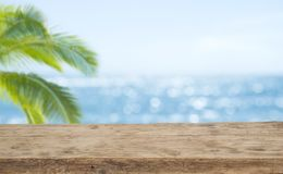 Free Defocused Sea Background With Wooden Table Foreground For Product Display Stock Photography - 143889412