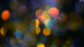 Defocused shimmering multicolored glitter confetti, black background. Holiday abstract festive bokeh light spots. Defocused shimmering multicolored glitter stock video