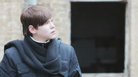 Defocused silhouette of sad seminary student looking around in deserted place. Stock footage stock video footage