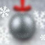 Defocused silver christmas ball. Royalty Free Stock Image