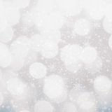 Defocused silver and white Christmas Bokeh background with snowf Royalty Free Stock Images