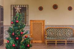 A defocused and simple Christmas tree. A simple and unfocused christmas tree with some red balls royalty free stock images