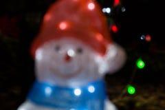 Defocused Snowman  bokeh on christmas light Stock Photography