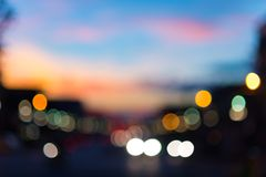 Defocused traffic and city lights on urban big street at dusk. Defocused traffic and city lights on urban big street at dusk Royalty Free Stock Image