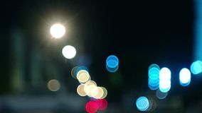 Defocused traffic in a city at night time. Blurred traffic in city at night time stock video