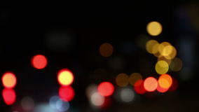 Defocused traffic lights of the night city road stock video footage