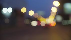 Defocused traffic lights at night in Moscow. 4K. Out of focus stock footage