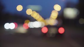 Defocused traffic lights at night in Moscow. 4K. Out of focus stock video footage