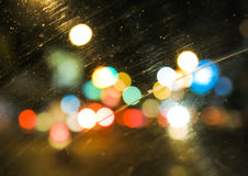Defocused traffic lights. View of defocused traffic lights from inside a car Royalty Free Stock Images
