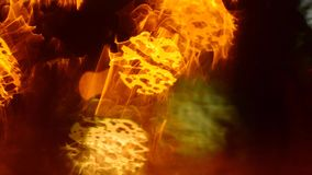 Defocused traffic lights through wet car glass. Rainy night. Colorful abstract background stock video footage