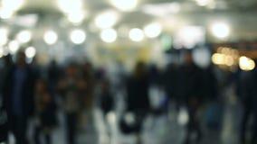 Defocused traveler and crowded people walking . Defocused traveler and crowded people walking in the airport stock video