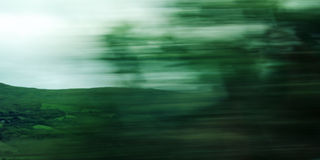 Defocused trees viewed through a car windscreen. Royalty Free Stock Photos