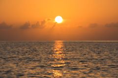 Defocused tropical ocean sunset background Stock Photos