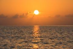 Defocused tropical ocean sunset background Stock Photos