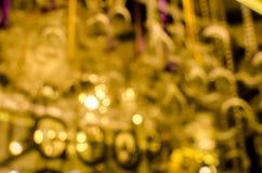 Defocused unscharfer Goldfarbzusammenfassungs-Beschaffenheitshintergrund Lizenzfreies Stockbild